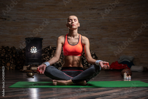 Full length of calm lady meditating with her legs crossed