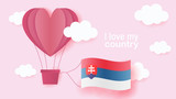 Hot air balloons in shape of heart flying in clouds with national flag of Slovakia. Paper art and cut, origami style with love to Slovakia