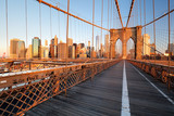 Brooklyn Bridge over East River viewed from New York City Lower Manhattan waterfront at sunset. - 245878703