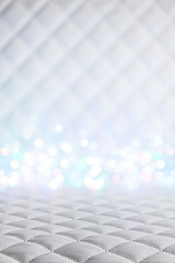 Interior background - white leather cloth on table and wall and blurry lights