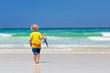 Leinwandbild Motiv Child snorkeling on tropical beach. Kids snorkel.