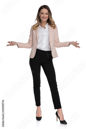 Leinwandbild Motiv sexy blonde businesswoman makes open hand gesture