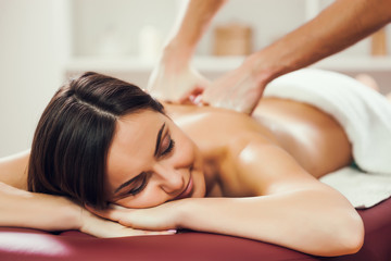 Young woman is enjoying massage on spa treatment.  © djoronimo