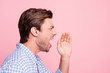 Leinwandbild Motiv Close up side profile photo of yelling with voice attractive he him his man  to empty space need to warn everybody before important event wearing casual shirt outfit isolated on pale rose background