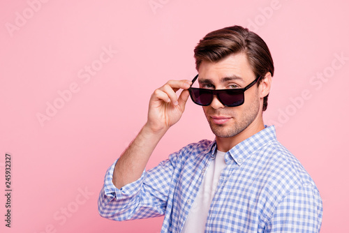 Leinwanddruck Bild Close up photo of beautiful amazing brunet he him his handsome self-confidently look on she her girl flirt wearing specs casual checkered plaid shirt outfit isolated on rose background