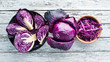 Quadro Red cabbage. Purple cabbage on a white wooden background. Organic food. Top view. Free space for your text.
