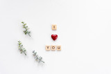 I love you words on white marble background.