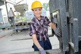 happy female construction worker - 245951766