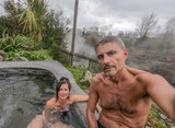 Happy couple taking a selfie in a thermal pool, New Zealand - 245957911