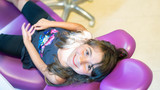 Smiling little girl sitting in a pink chair in a dentist office - 245961185