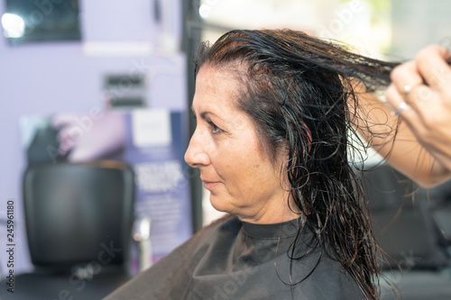 Lady with long wet hair at the hairdresser's