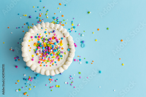 Leinwandbild Motiv Colorful birthday cake top view