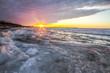 Scenic Winter Sunrise Landscape. Scenic sunrise reflection over the icy Great Lakes horizon on the coast of Lake Huron.