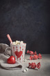 Hot chocolate with marshmallows,white cup with heart on the table, greeting text - 245975108