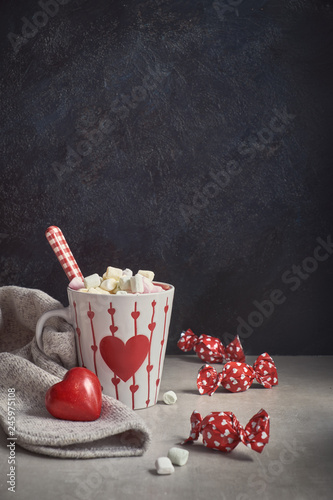 fototapeta na ścianę Hot chocolate with marshmallows,white cup with heart on the table, greeting text
