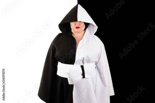 fototapeta na ścianę fat woman with hood in beautiful black and white dress on black and white background