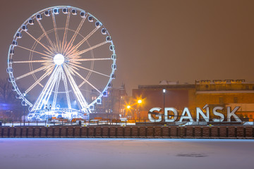 Gdansk city outdoor sign at snowy winter, Poland