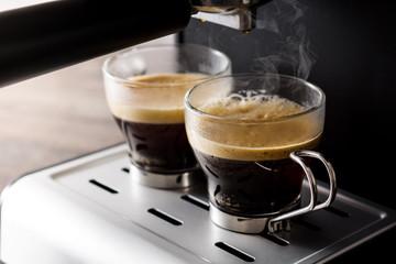 Close up fresh coffee in espresso coffee machine