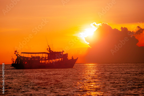 tourist scuba diving boat and beautiful sunset sky at koh tao thailand