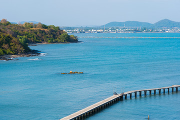 sea with wooden bridge at Rayong,Thailand