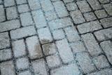 Melting salt on the sidewalk in winter season - 246077556