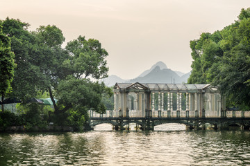 Wonderful glass bridge on lake in Guilin at sunset, China