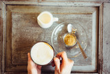 Woman hold coffee cup in her hands in vintage coffee shop. - 246097346