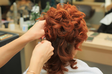 Hairdresser makes beautifull hairstyle at the salon