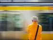 Man waiting train on platform Tokyo Japan city lifestyle