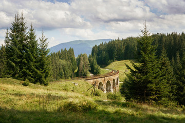 Landscape with railway viaduct traine bridge in Ukraine.