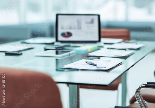 workplace with laptop and working documents for the business team in a modern office - 246151520