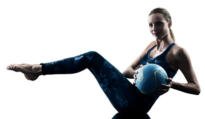 one caucasian woman exercising fitness Medicine Ball excercises in silhouette isolated on white background © snaptitude