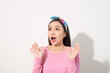 Asian Young Woman in Surprising Emotion, Face Look up above with opened mouth and hands, Emotional of Female Concept, Front view