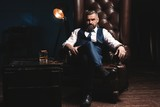Attractive man with cigar and a glass whiskey - 246174114