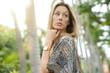 Beautiful bohemian woman posing in exotic setting