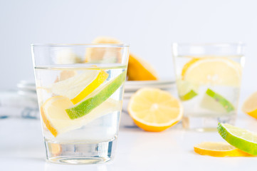 Glass of water with lemon and lime in it
