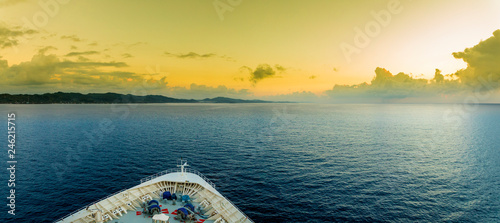 Panoramic view of the bow of a ship as it approaches the tropical island of Roatan.