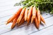 Bunch of fresh carrot on wooden table