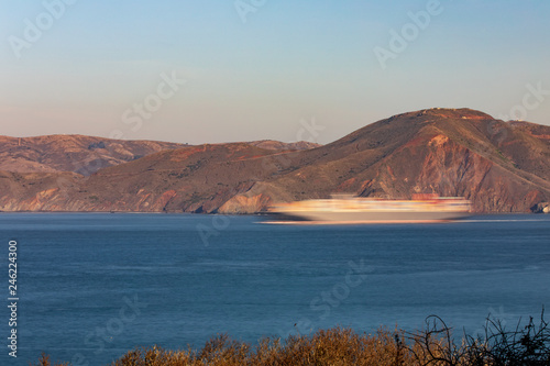fototapeta na ścianę Blurred cargo ship going through the Golden Gate