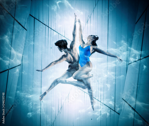 Young couple ballet dancing on futuristic background © Andrey Burmakin