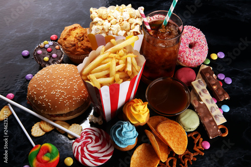 Foto Murales Unhealthy products. food bad for figure, skin, heart and teeth.