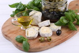 Cheese Saint-Mor-de-Touren with basil and olives - 246254320