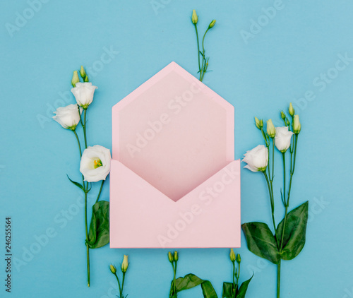 White roses with pink envelope