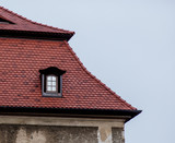 One small window in a roof a castle in Poland, Europe