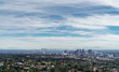 Aerial view of Los Angeles, California. View toward the Wilshire district and downtown. Hills in background. Blue sky and clouds. Room for text..