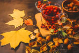 rosehip tea and medlar fruits on a dark wooden background. - 246304732
