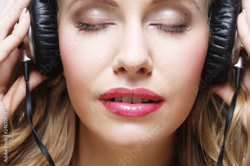 Rock style woman with headphones listening to music - 246308797