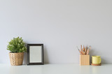 pencil, coffee, photo frame and plant on copy space, office desk. - 246314902