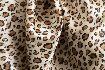 the texture of silk fabric in the color of leopard