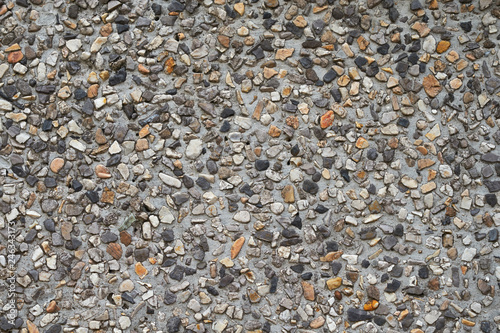 pebble stones in a concrete wall texture - 246343173